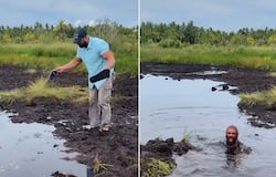 Watch: Man gets submerged in muddy water while crossing a swamp; watch viral video