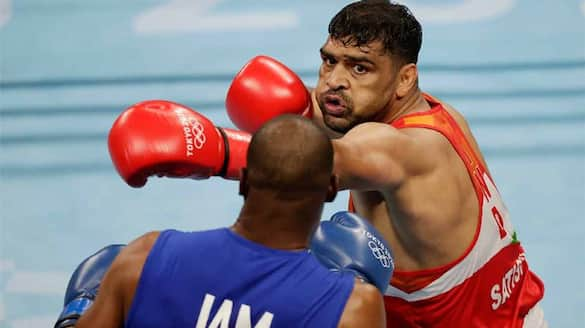 Satish Kumar into the Quarter finals of Heavyweight category