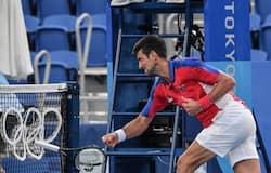 Djokovic smashes his racket