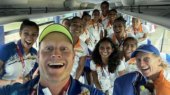 Indian women's team coach sjoerd Marijne celebrate with his team after beat Australia in Tokyo Olympics spb