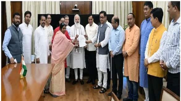 BJP MPs meet pm Narendra modi as Assam Mizoram border row and submit memorandum bsm