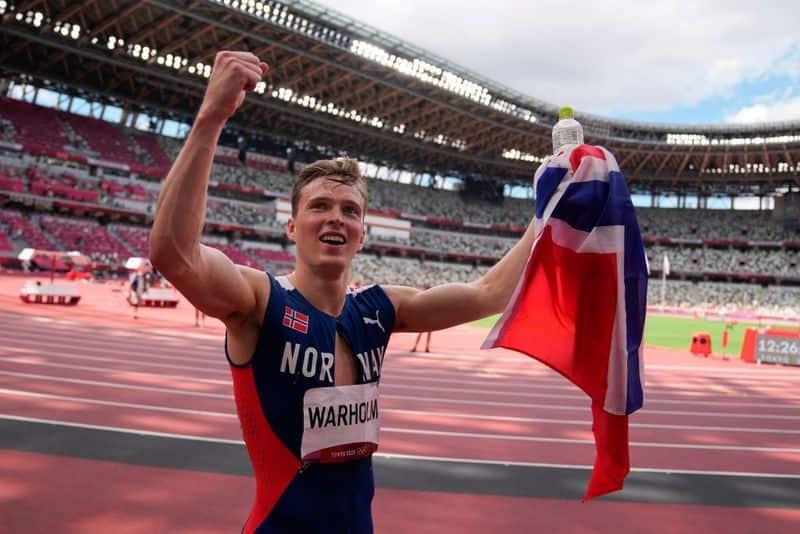 Karsten Warholm of Norway wins 400m hurdles in world record time