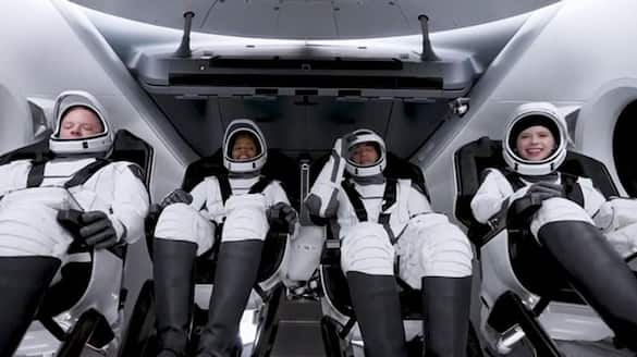 four civilians landed safely on earth after three days of space tour