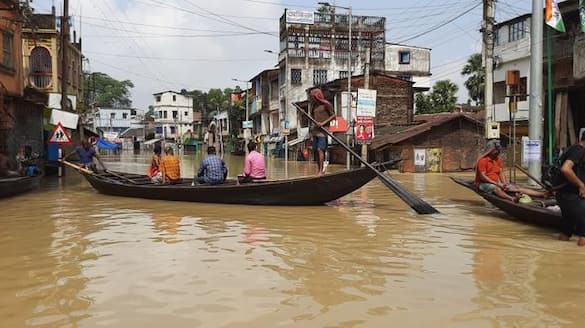 waterlogged in Ghatal due to heavy rain locals have started travel by boat on road bmm