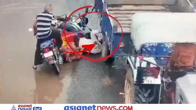 Viral Shocking accident video of tractor wheel passing through biker head