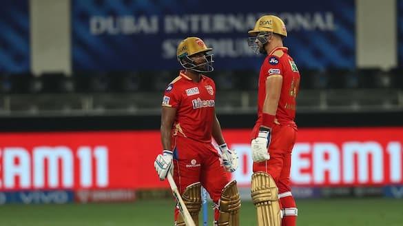 IPL 2021 Mumbai Indians restrict Punjab kings by 135 runs in abu dhabi ckm