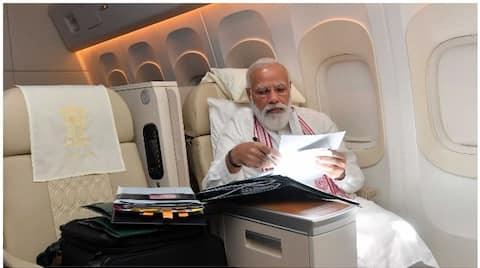 pm Narendra Modi's tweet during his visit to  US, where he is busy looking at files bsm