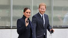 Proud dad! Prince Harry carries briefcase with 'Archie's Papa' embossed on it