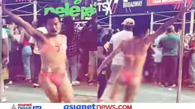 Suddenly a man came wearing a bikini on the middle of the road, did pole dance, see video