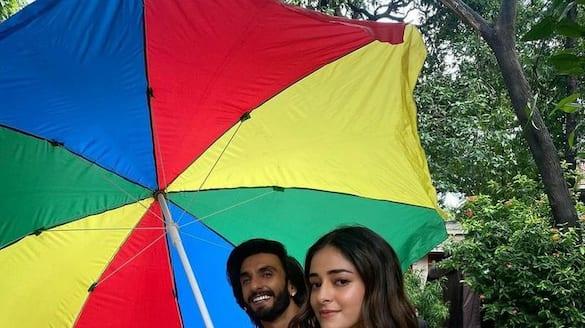 Ranveer Singh holds an umbrella for Ananya Panday dpl