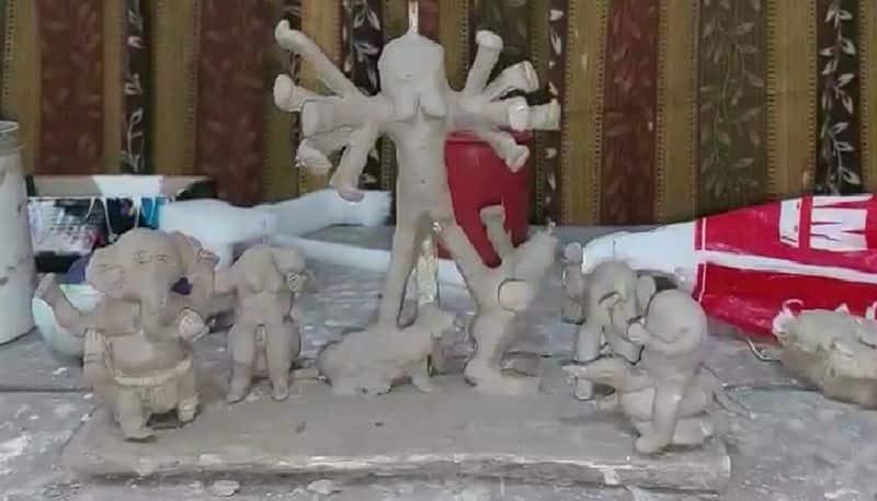 Anik Mandal, a resident of Kasba in Raiganj, made a clay Durga idol bpsb