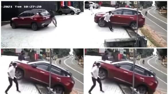 SUV rolls-down-dealership Showroom viral video
