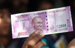 2000 note in hand