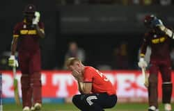 England's Ben Stokes(C) reacts after being hit for consecutive sixes in the World T20 cricket tournament final match between England and West Indies at The Eden Gardens Cricket Stadium in Kolkata on April 3, 2016.
