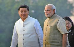 Indian Prime Minister Narendra Modi and Chinese President Xi Jinping take a stroll along the Sabarmati river on September 17, 2014 in Ahmedabad, India. Xi is traveling in India during the three day visit to discuss trade, infrastructure and territorial disputes with Modi.
