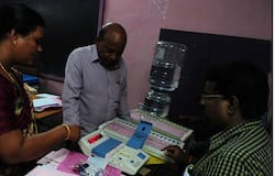 Indian polling officials check electronic voting machines at a polling centre in Chennai on May 15, 2016. AFP Photo
