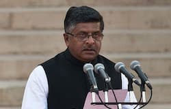 In this photograph taken on May 26, 2014, Bharatiya Janata Party (BJP) leader Ravi Shankar Prasad takes the oath of office during a swearing-in ceremony for new Indian Prime Minister Narendra Modi and his council of ministers in New Delhi. AFP Photo
